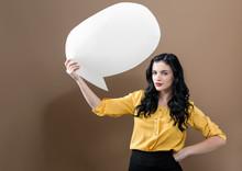 Young Woman Holding A Speech B...