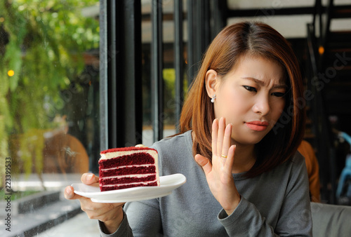 Asian girl refuses cake because she is controlling her calories,Dieting,Cake is Canvas Print