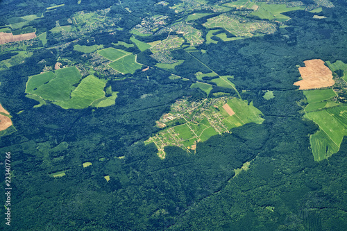 Papiers peints Bleu vert view from a great height to plain covered with forest