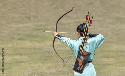 mongolian women practicing archery skills Wallpaper Mural