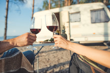 Cropped View Of Couple Clinking With Glasses Of Wine During Picnic In Camp