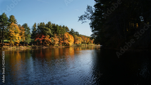 Foto op Canvas Herfst Beautiful scene of the colorful foliage of the trees in autumn fall season reflection in the black water river