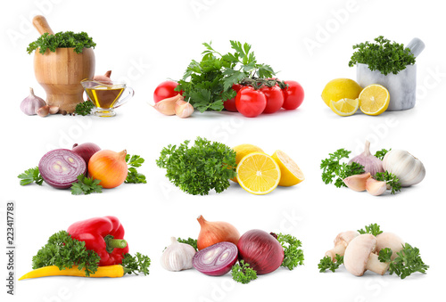 Set with fresh parsley, lemons and vegetables on white background