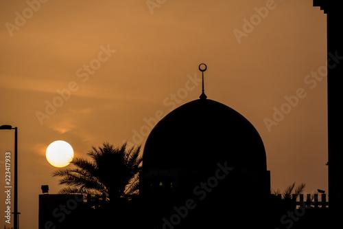 Fotografie, Obraz  Feb 20, 2018: Mosque's Dome Silhouette against Orange Sky at sunset Abu Dhabi, U
