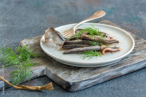 Anchovies in olive oil with fresh dill. Canvas Print