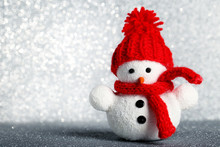 Small Snowman Toy On Lights Background