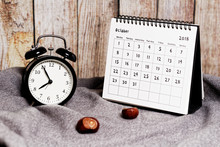 Five To Eight On Vintage Clock, Chestnuts And October 2018 Calendar. Autumn Time And Mood
