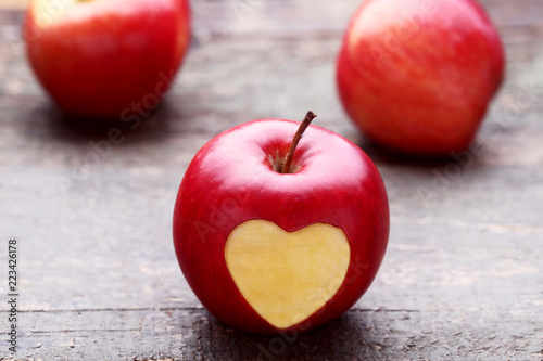 Red Apple With Cutout Heart Shape On Grey Wooden Table Buy