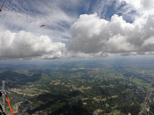 flying through the clouds in paraglide