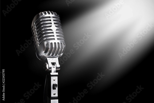 Fototapeta Retro style microphone on  background obraz