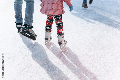 Canvas Print People ride on the skating rink on the ice rink during the Christmas holidays