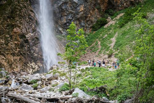 Logarska Dolina, Slovenia - June 9, 2018: Tourists people visiting waterfall rinka in logar valley, slovenia
