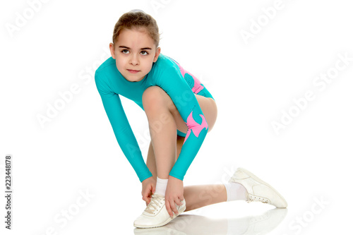 Young girl acrobat perform exercises.