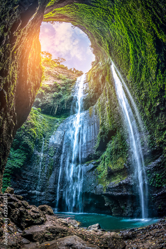 Photo Stands Waterfalls Madakaripura Waterfall is the tallest waterfall in deep Forest in East Java, Indonesia.