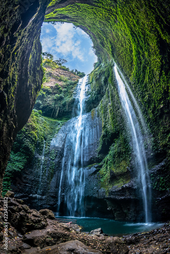 Recess Fitting Waterfalls Madakaripura Waterfall is the tallest waterfall in Deep Forest in East Java, Indonesia.