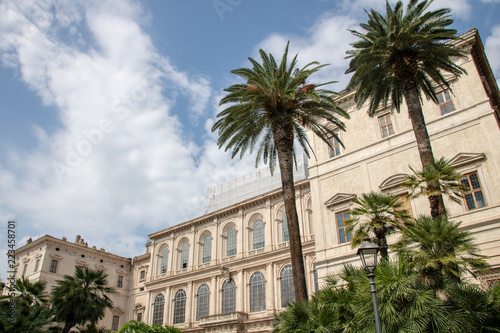 Foto op Plexiglas Stadion Roman building Italy and palm trees