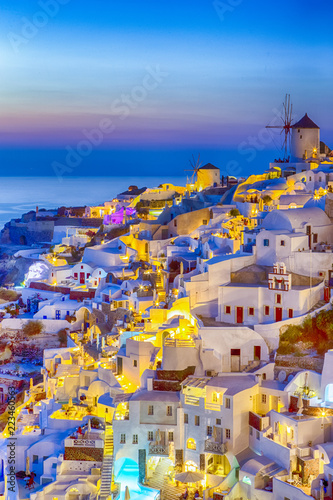 Foto op Aluminium Zalm Traveling and New Destinations Concepts. Romantic Sunset at Santorini Island in Greece. Image Taken in Oia Village At Dusk. Amazing Sunset with White Houses and Windmills in Frame.