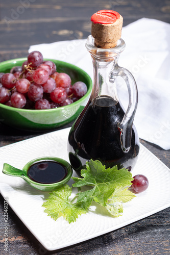 Black aged natural balsamic vinegar dressing from Modena, Italy