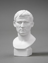 A Plaster Figure With A Gray Background