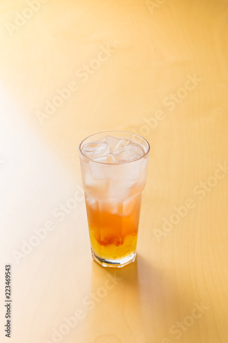 peach ade on the wooden table Canvas Print