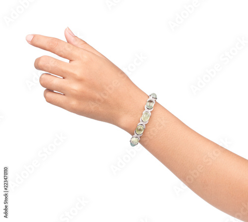 Photographie bracelet inlaid with gemstones on hand isolated on white background
