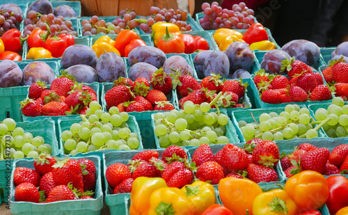 Rows of baskets filled with colorful fruits at the farmers market