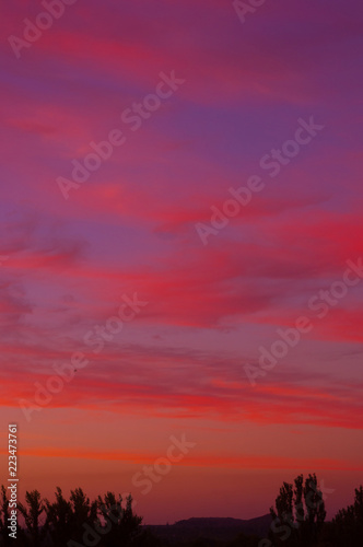 Foto op Plexiglas Crimson Landscape with dramatic light - beautiful golden sunset with saturated sky and clouds.