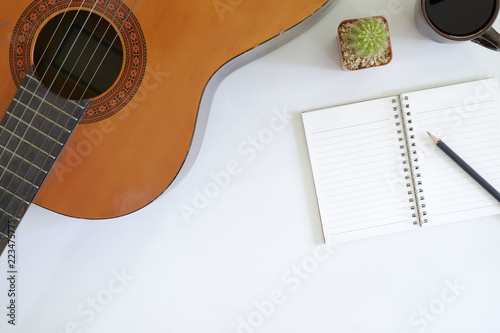 Photo song writer table a workspace with musician acoustic guitar and coffee cup with notepad paper on top view desk