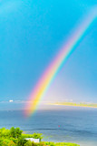Fototapeta Tęcza - Rainbow over the Volga River after the rain. Nature of Russia