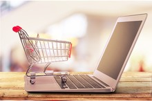 Online Shopping Concept With Laptop And Shopping