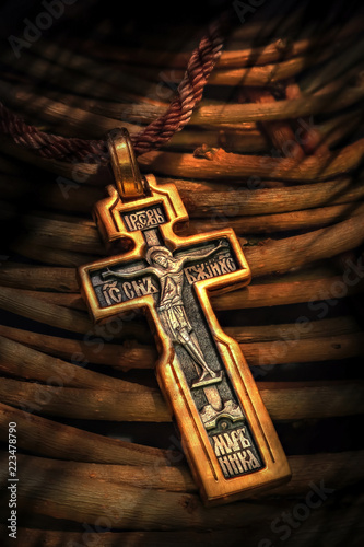 Obraz na plátne the orthodox cross lies on wooden rods of a willow