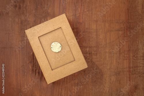 Fotografering  An overhead photo of a mysterious box on a dark rustic background with copy spac