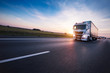 canvas print picture - Loaded European truck on motorway in sunset