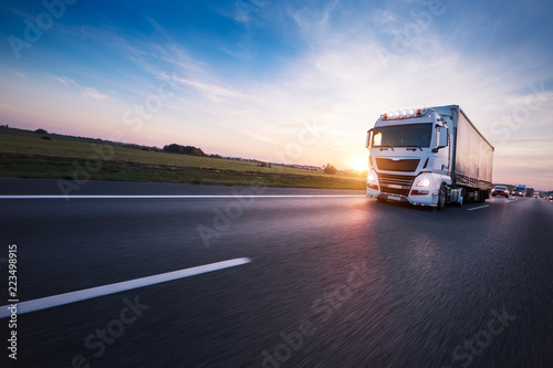 Loaded European truck on motorway in sunset