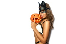 Sexy Girl With Halloween Pumpkin In Black Leather Cat Mask On White Isolated Background