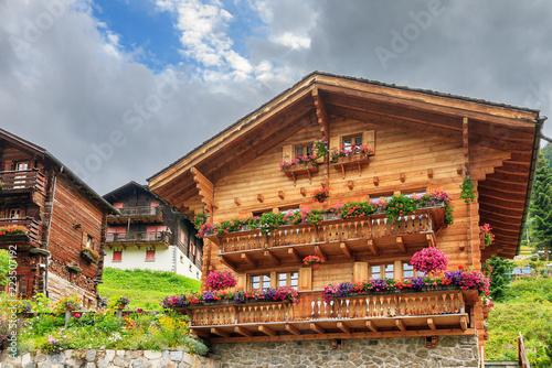 Obraz na plátně  Beautiful traditional wooden houses in the alpine village Grimentz, Switzerland,