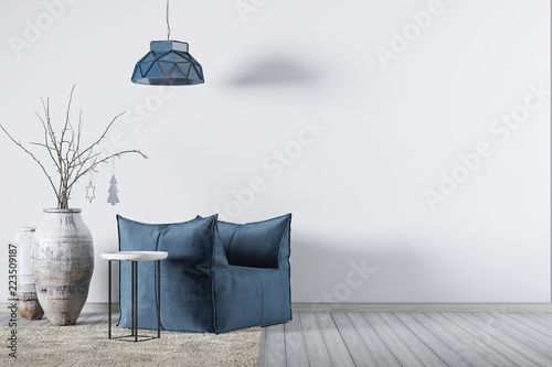 Fotografia Interior with background empty wall and blue armchair with little table and lamp