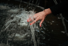 Water Spray On The Hand
