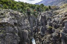 Hikers Crossing Suspension Bridge, Parque Patagonia, Chile