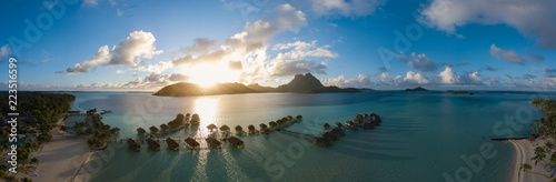 Fotografia  Panoramic aerial view of luxury overwater villas with palm trees, blue lagoon, w
