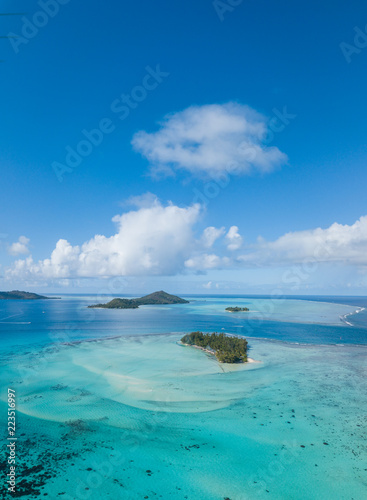 Fototapeta Aerial from a drone of blue lagoon and Otemanu mountain at Bora Bora island, Tah