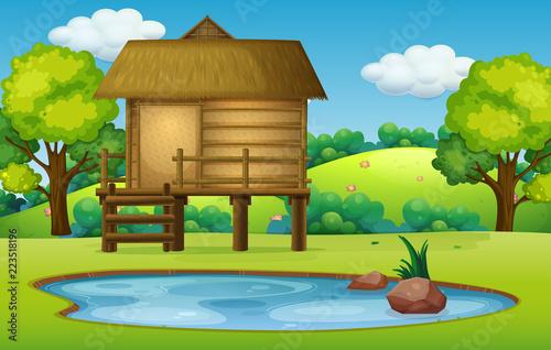 Keuken foto achterwand Kids Hut in pond nature scene