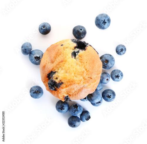 Fotografia Tasty blueberry muffin on white background