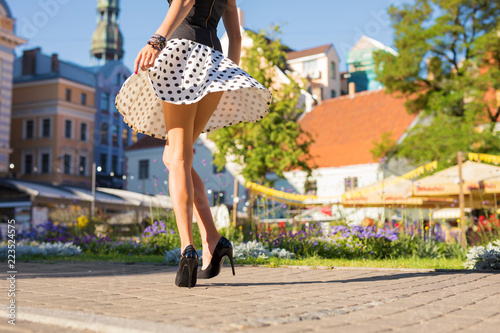 Woman with beautiful legs wearing skirt and heels Canvas Print