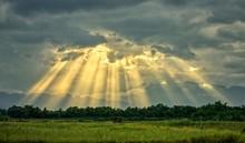 Sunbeam In Cloudy Sky Over Ric...