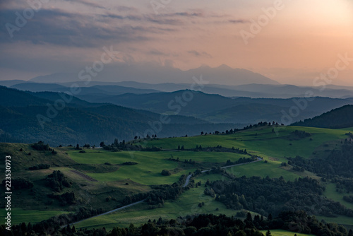 Spoed Foto op Canvas Zalm mountain fields landscape sunset