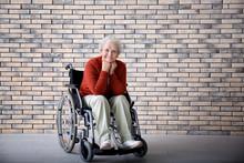 Senior Woman In Wheelchair Aga...