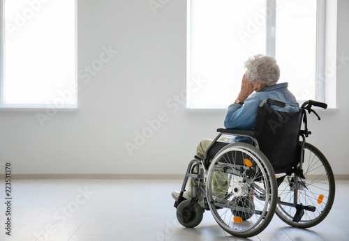 Lonely senior woman in wheelchair indoors