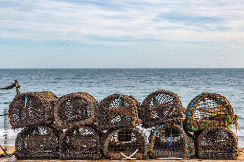 Lobster pots lined up on a beach, on the Isle of Wight Fototapeta