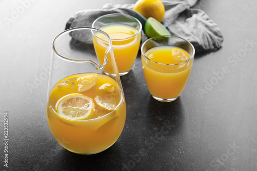 Glassware of fresh lemon juice on dark table